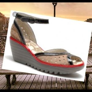Fly London Yedl perforated leather wedges .